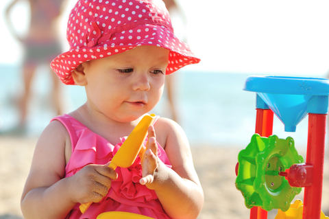 http://www.dreamstime.com/royalty-free-stock-photography-baby-beach-playing-toys-image30381717